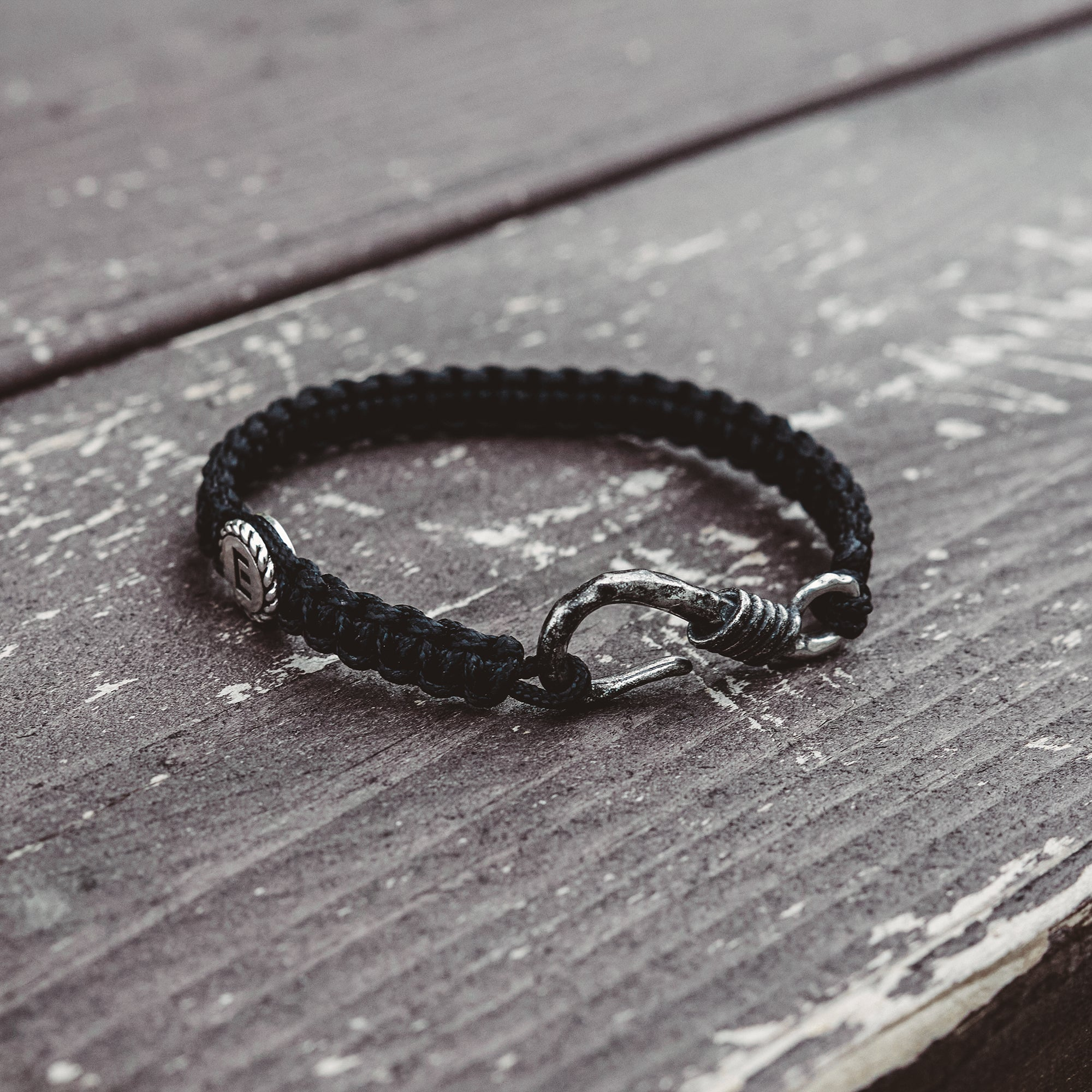 E-FISH | Black Woven Bracelet with Hook Closure and Small E Disk