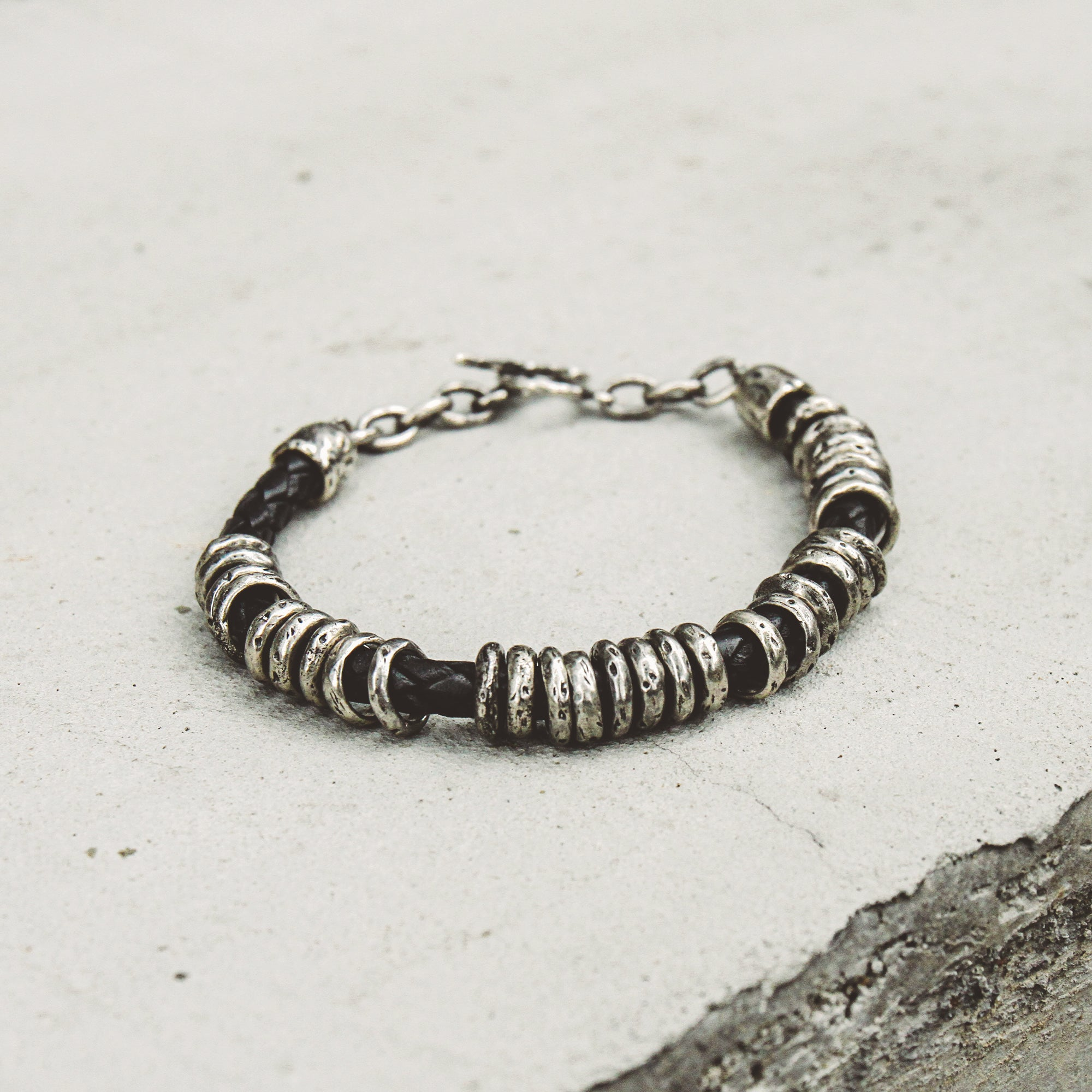 GRAVITY | Braided Leather Bracelet with Silver Rings