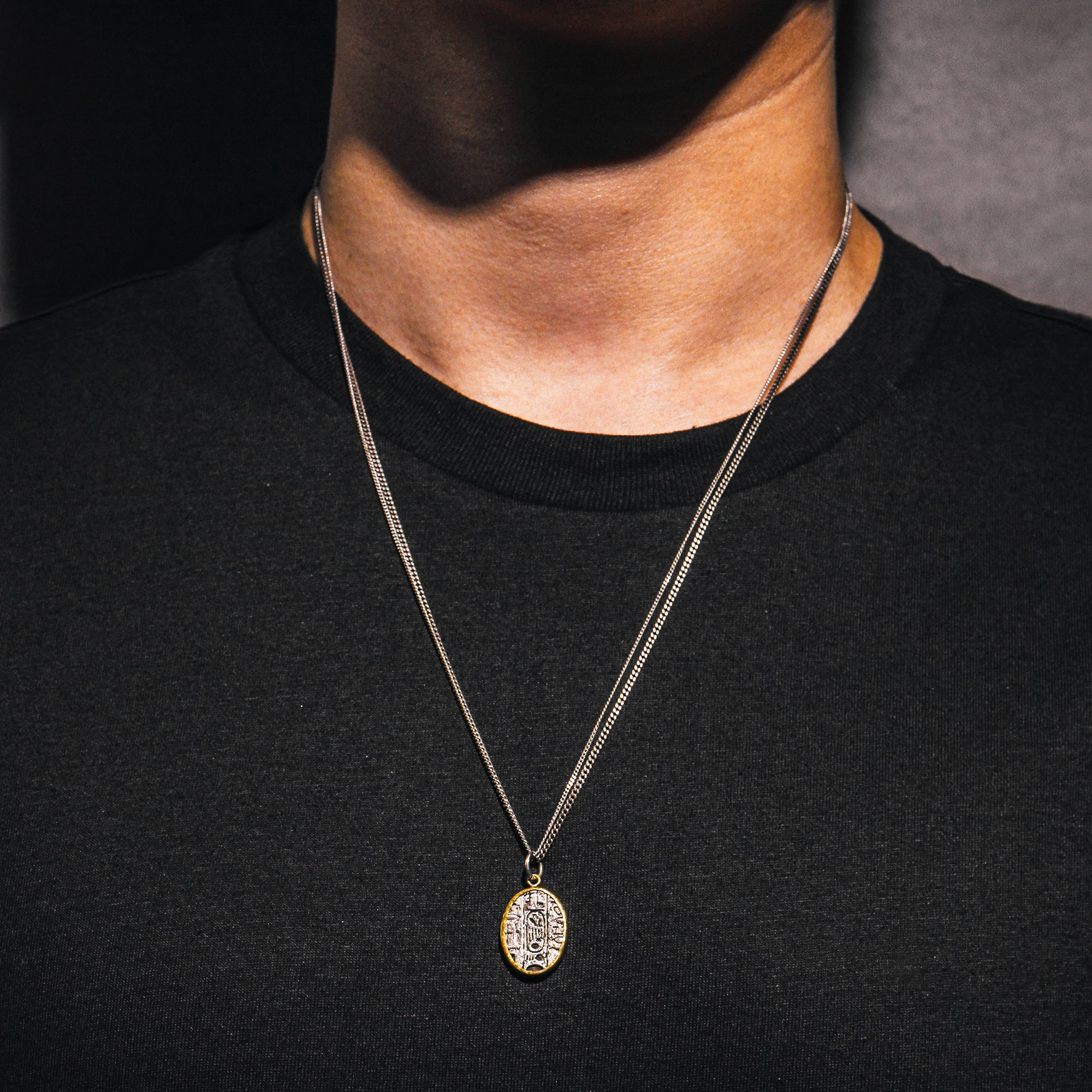 SUPREME | Silver Necklace with Gold Framed Oval Textured Pendant