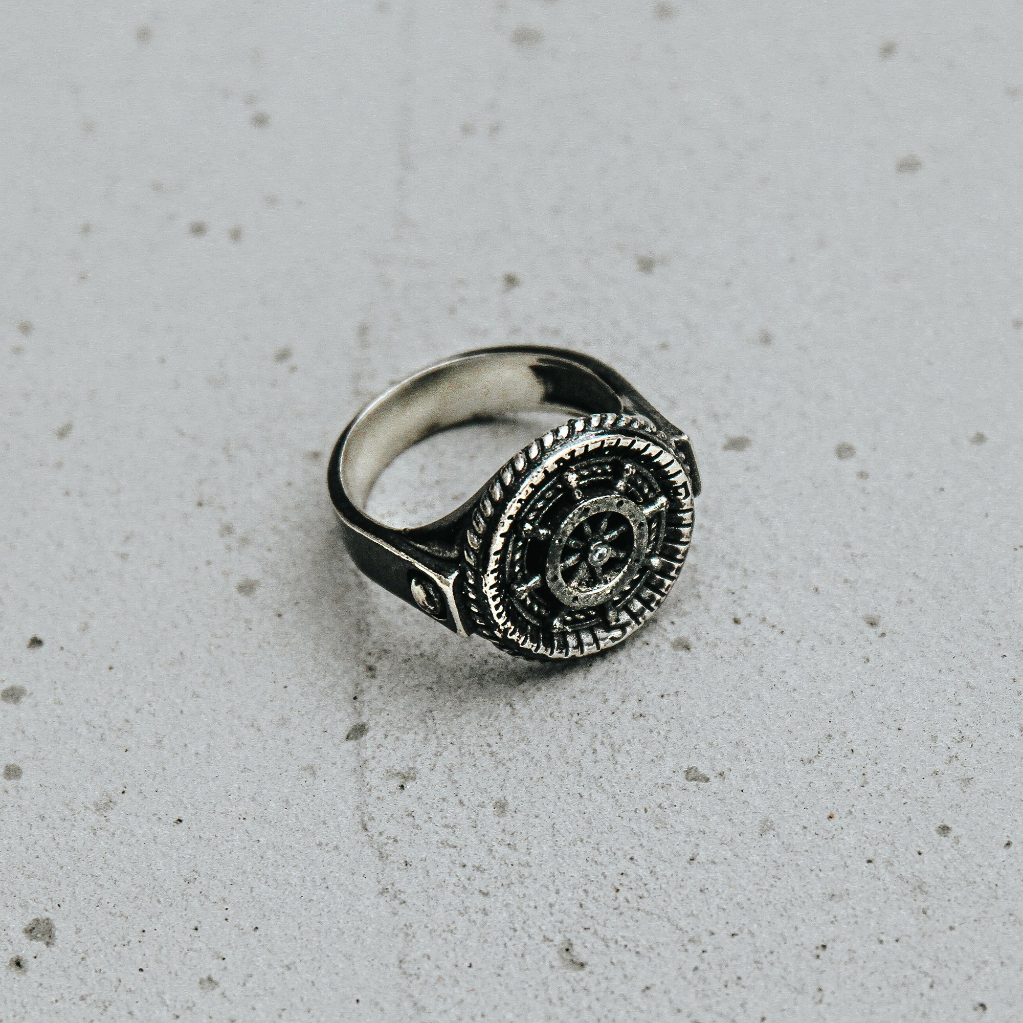 DIRECTIONS |  Silver Ring with Wheel Disk Band