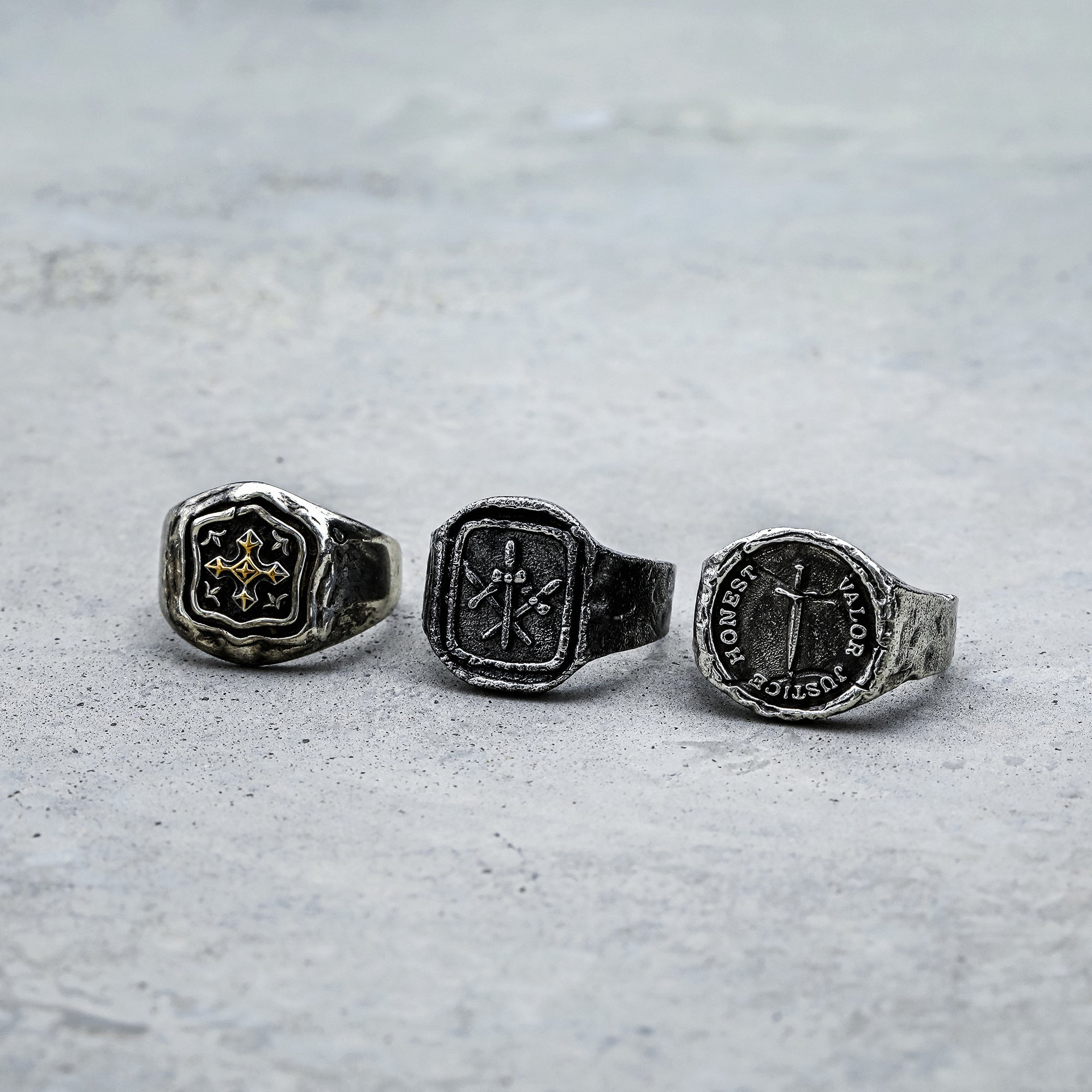 carved with three swords ring