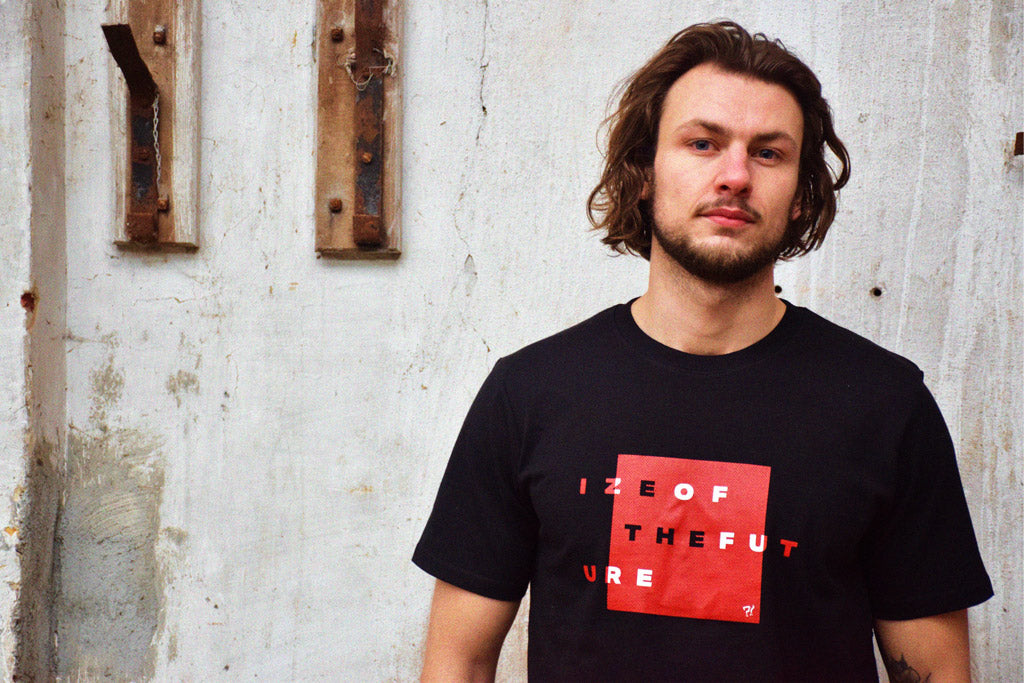 Model wearing black t-shirt with red and white graphic