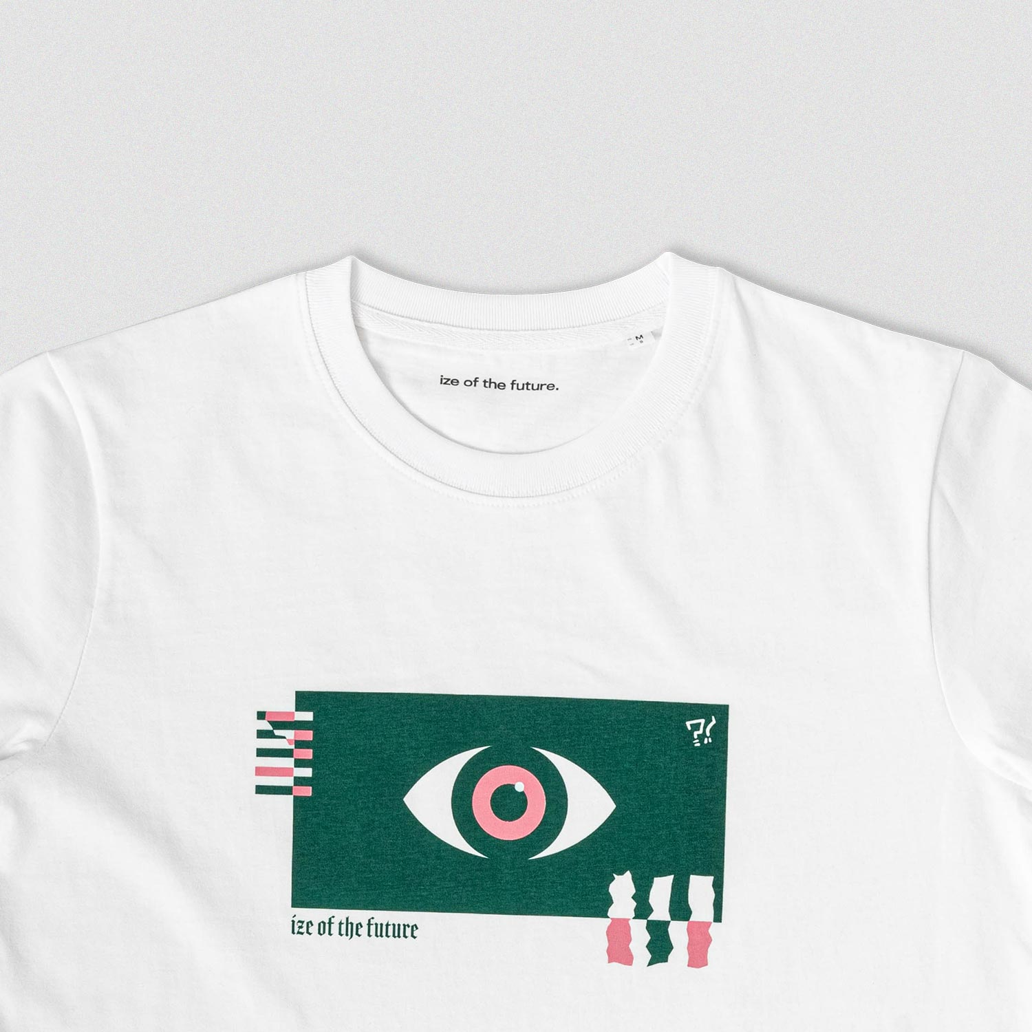 White t-shirt with green and pink graphic, zoomed in