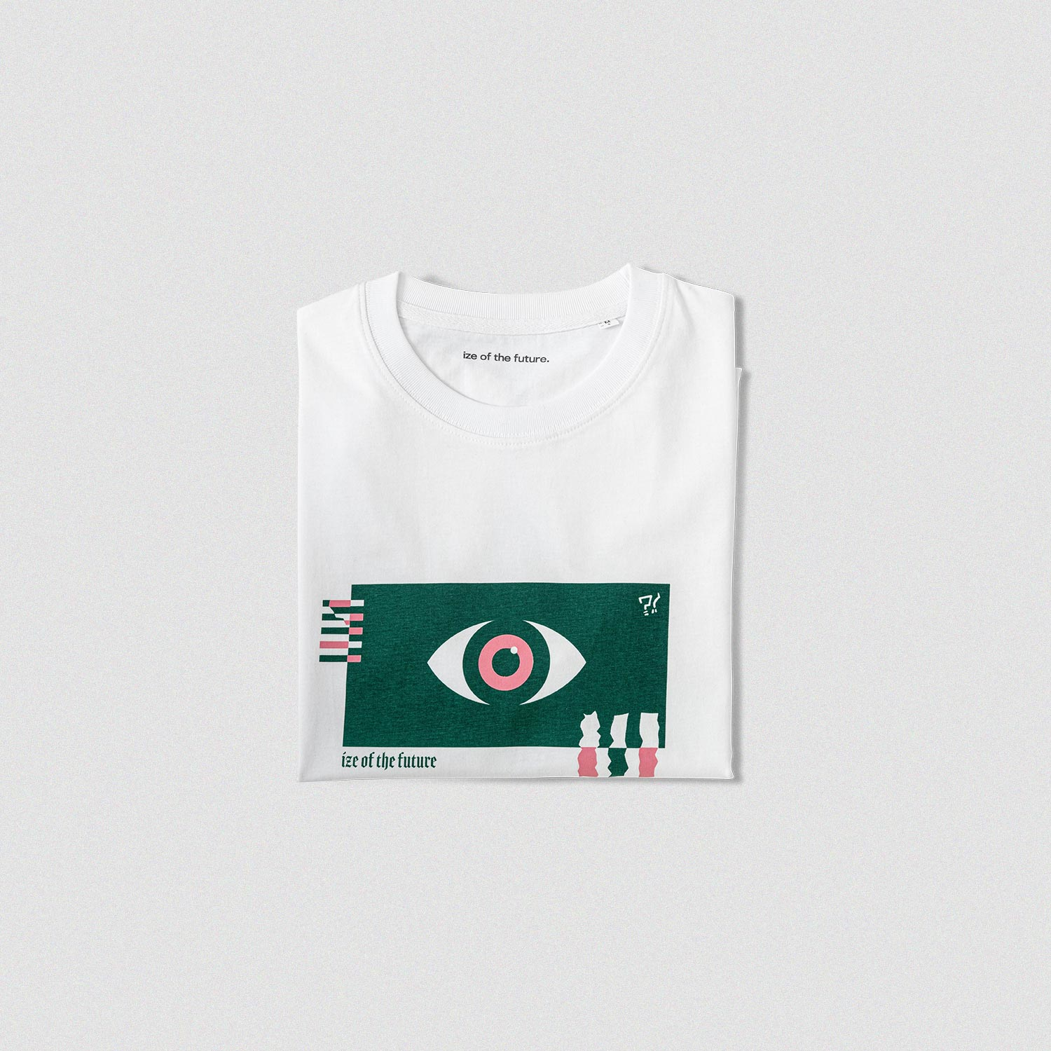 White t-shirt with green and pink graphic, folded up
