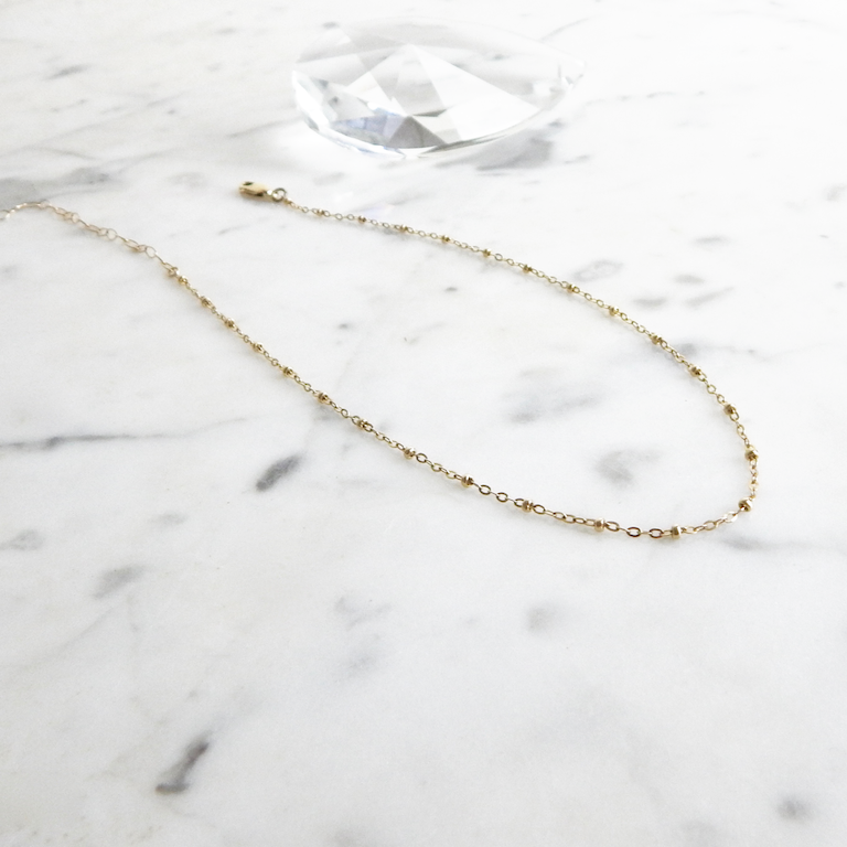 Taya - gold filled delicate saturn chain choker - flatlay