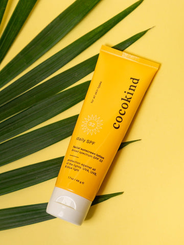 Cocokind spf in yellow bottle with yellow background