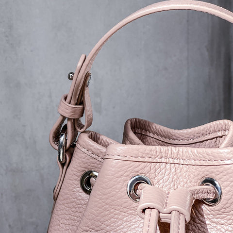sustainable pink leather bag with handle