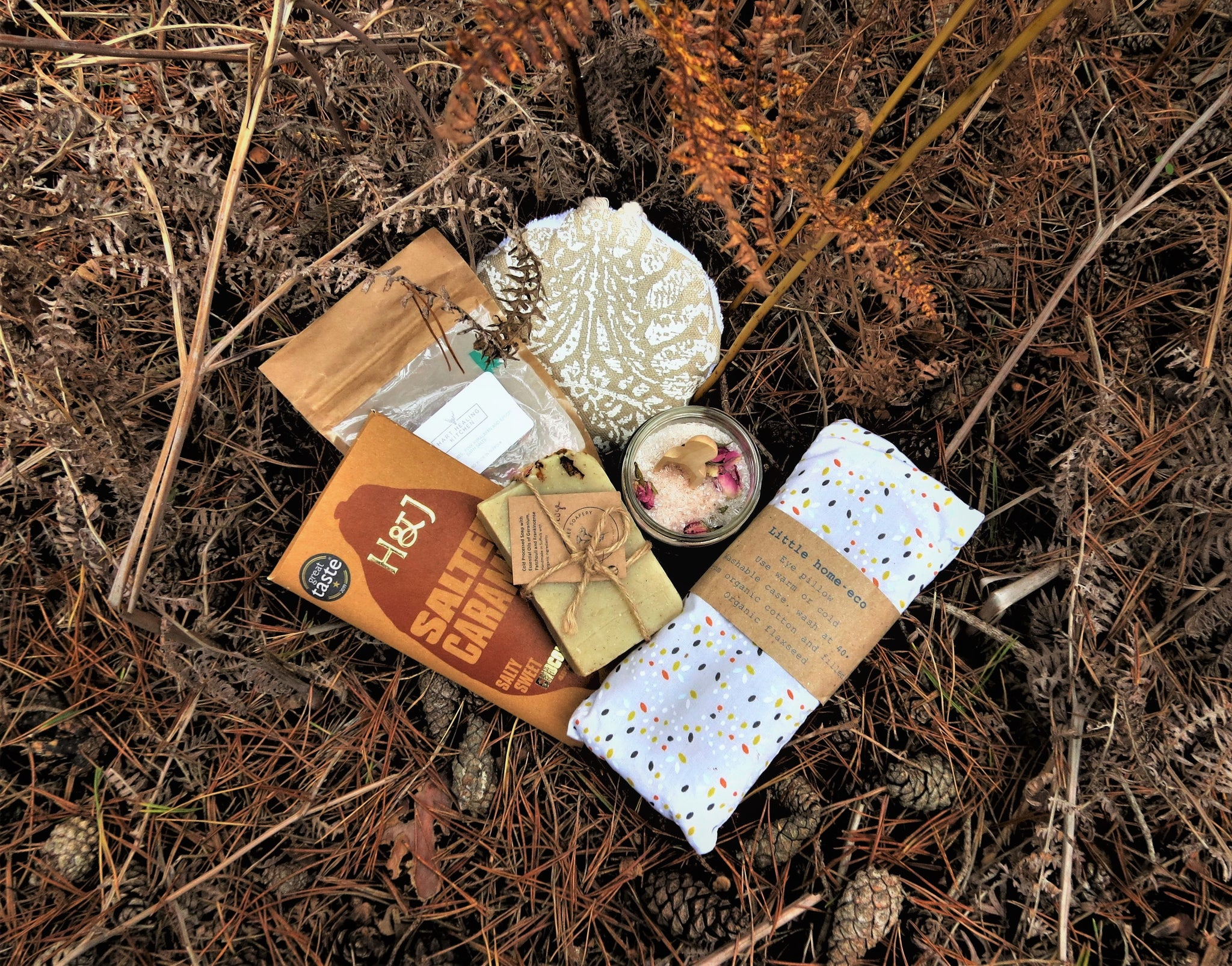The Bath Box contents, luxury body sponge, bath salts, organic eye pillow, Harris & James chocolate and rose petal soap