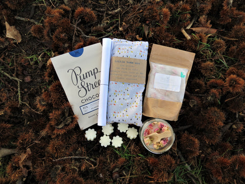 The Calm Box contents - Pump Street chocolate, bath salts, wax melts, organic eye pillow, guided yoga meditation