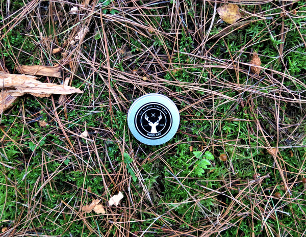 Woodland beard balm by The Bearded Stagg on a forest floor background