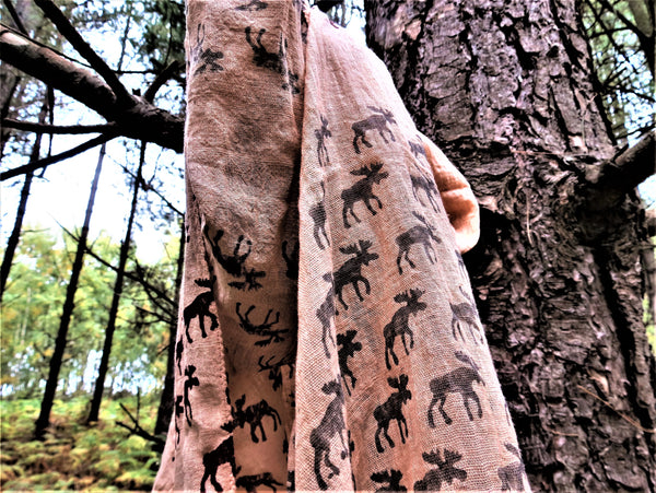 Moose scarf hanging from tree