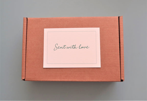 Box with 'Sent with love' card on top
