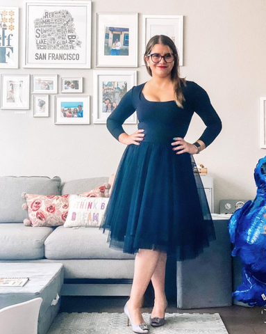 @lifewithbela wearing a Black Midi tutu tulle skirt for her instagram post. She has styled her black fashionable midi skirt with a top and some flat shoes