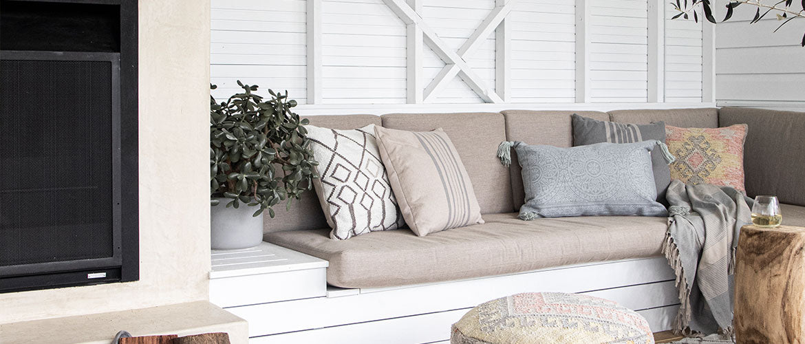 Weaver Green cushions on a bench seat