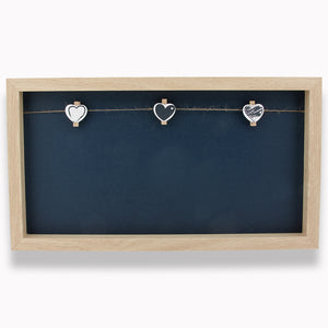 Framed Chalkboard with mini clothes pins for hanging pictures