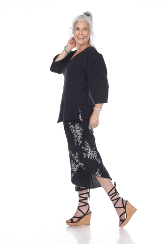 55% linen 45% eco-friendly rayon gaucho pant with front outside pockets, petal hem and flat elastic front and rushed elastic back.