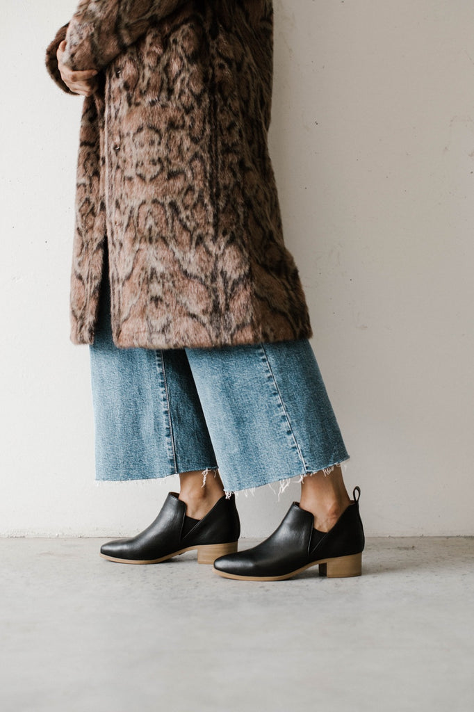 vegan leather boots and faux fur coat