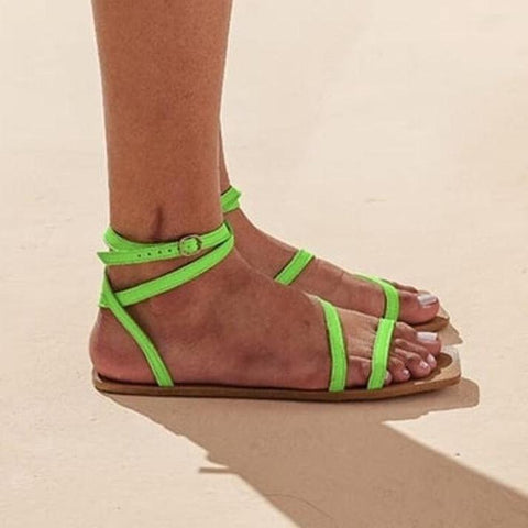 Flat vegan sandal by Arenaria - green