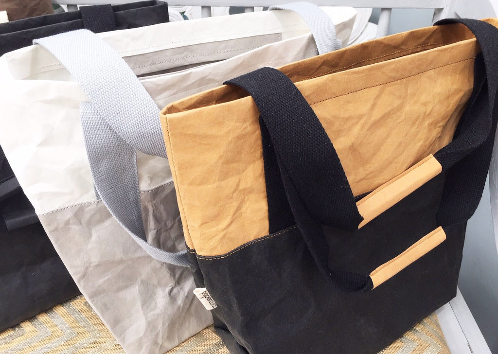 Chooses of plain or two tone combinations. Washable Paper shopping tote.