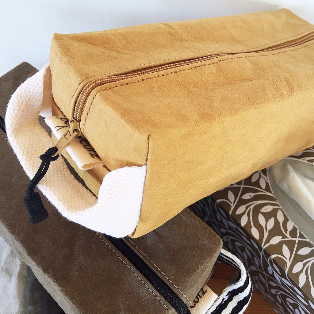 Sustainable man's toiletry bag that is multi functional. Handmade from eco and vegan friendly Washable Paper.