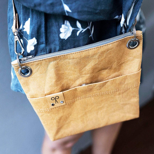 The Washable Paper crossbody shoulder bag is attractive enough to wear with your party dress and heels but casual enough to take when wearing your jeans and a T-shirt.