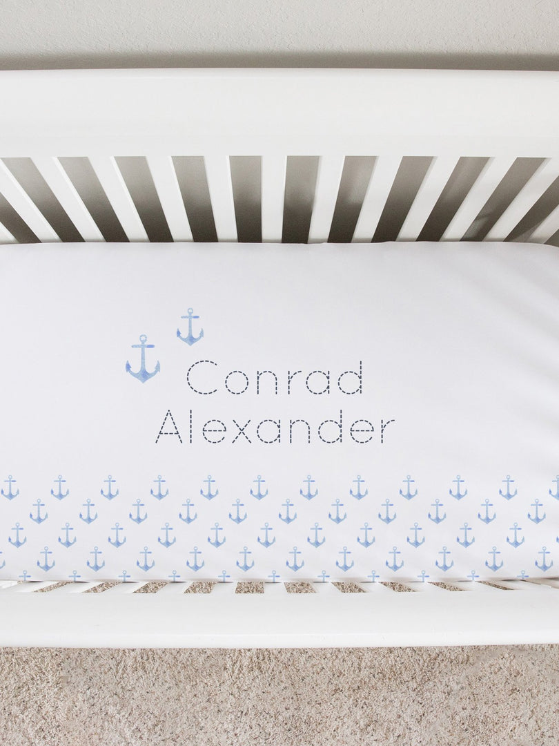 blue pastel anchors personalized crib sheet. nautical nursery bedding