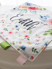 lovie baby blanket with bright flowers