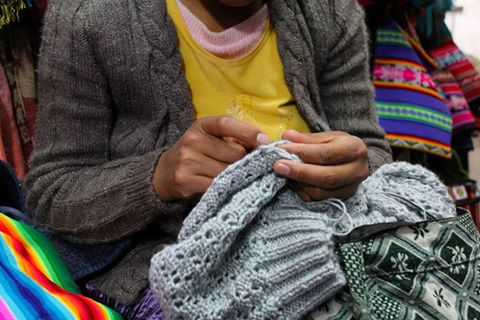 Bolivian artisans knitting a winter hat