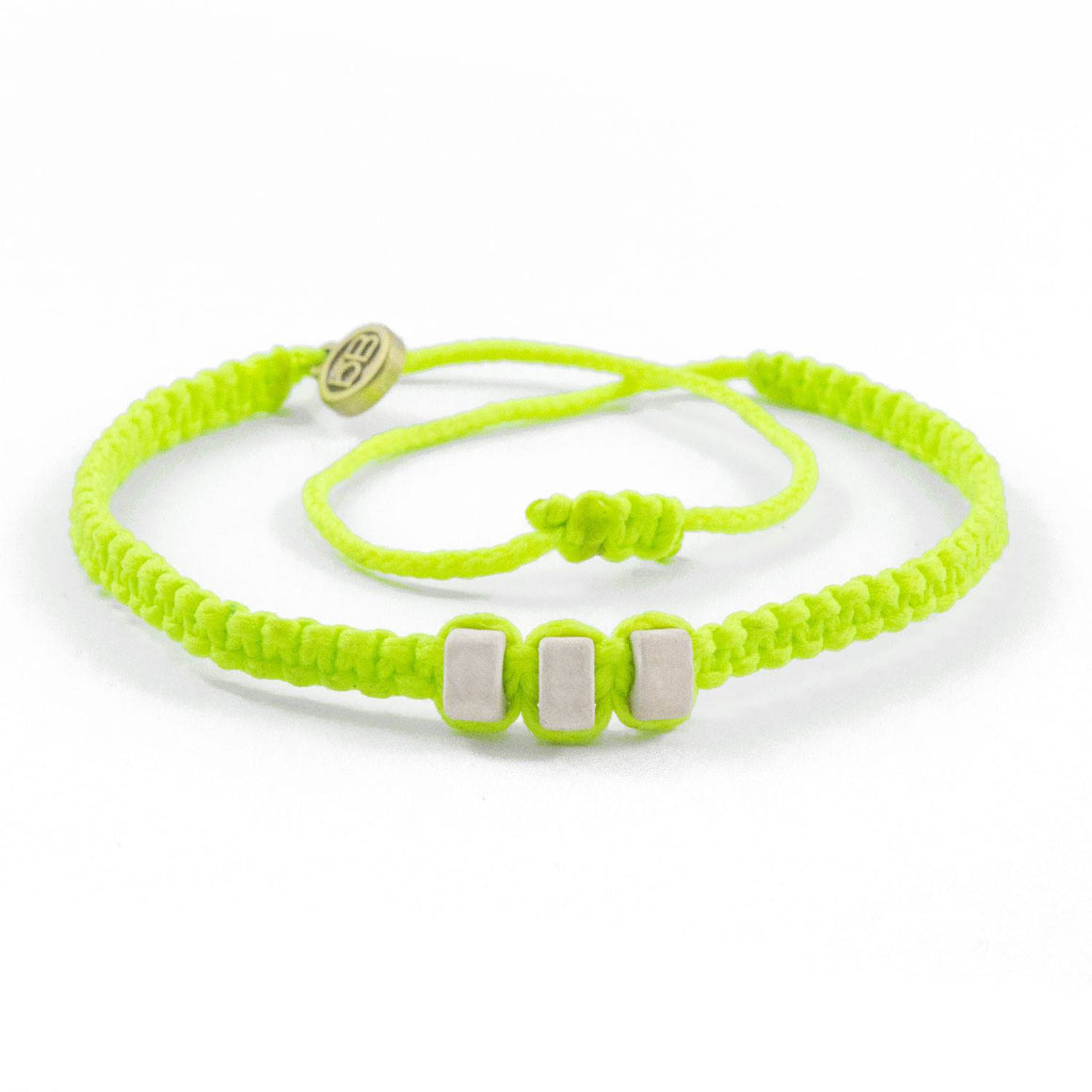 White Chasqui Electric Yellow bracelets that help children cover