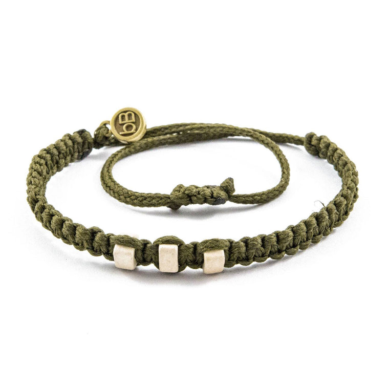 White Chasqui Military Green bracelets that help children cover