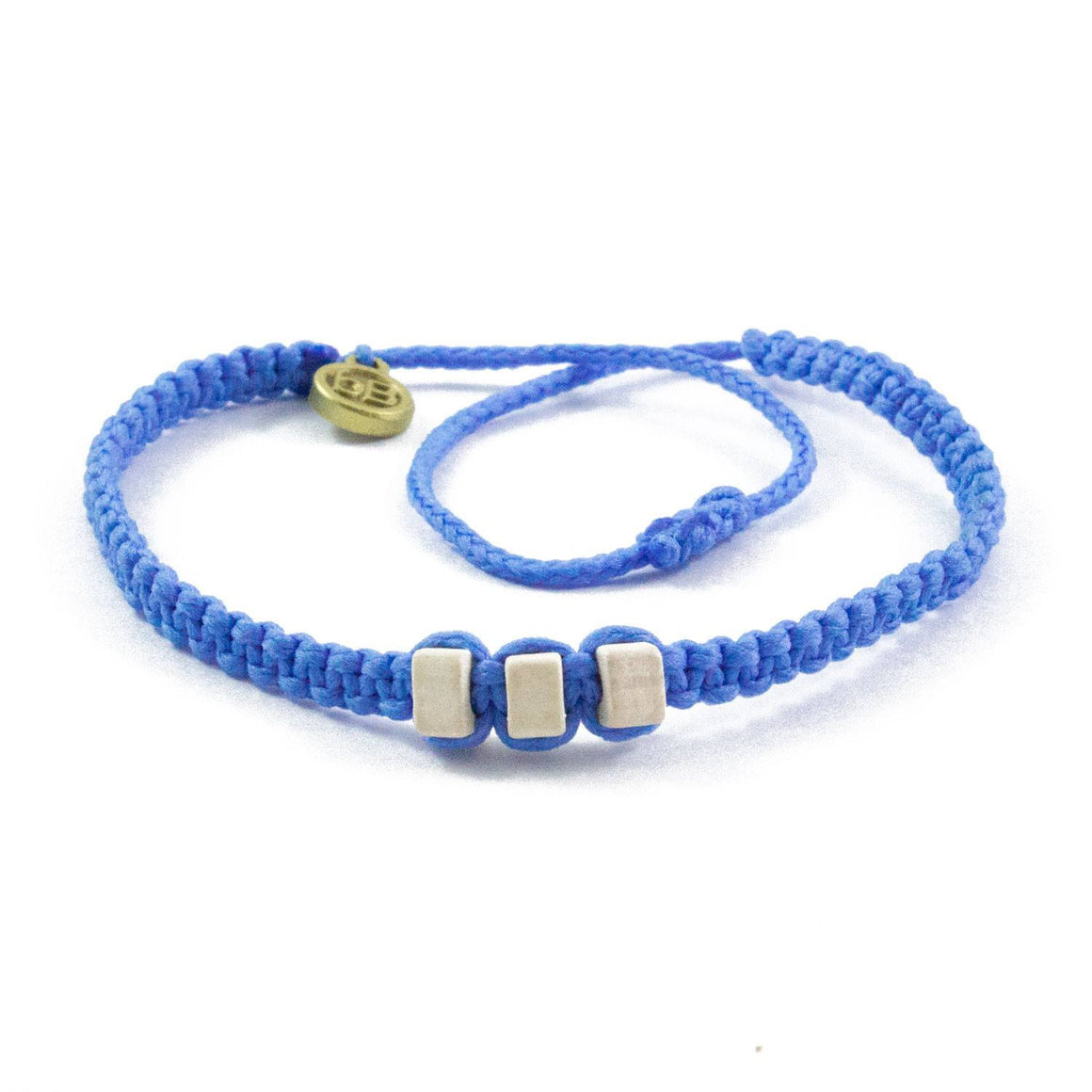 White Chasqui Sky Blue bracelets that help children cover