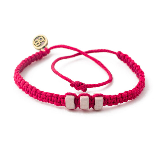 White Chasqui Candy Pink bracelets that help children cover