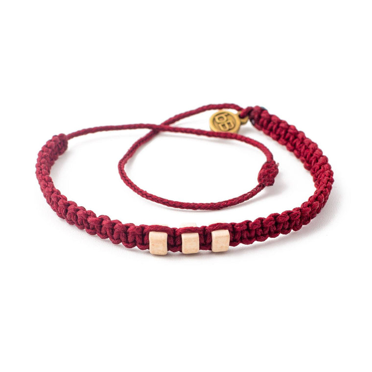 White Chasqui Red Cherry bracelets that help children cover