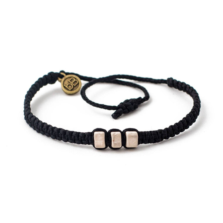 White Chasqui Carbon Black bracelets that help children cover
