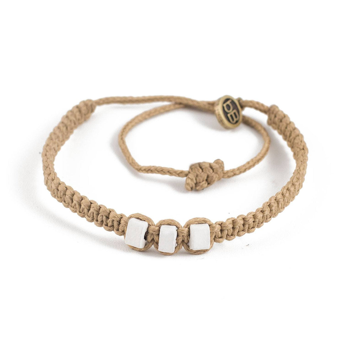 White Chasqui Arabic Camel bracelets that help children cover