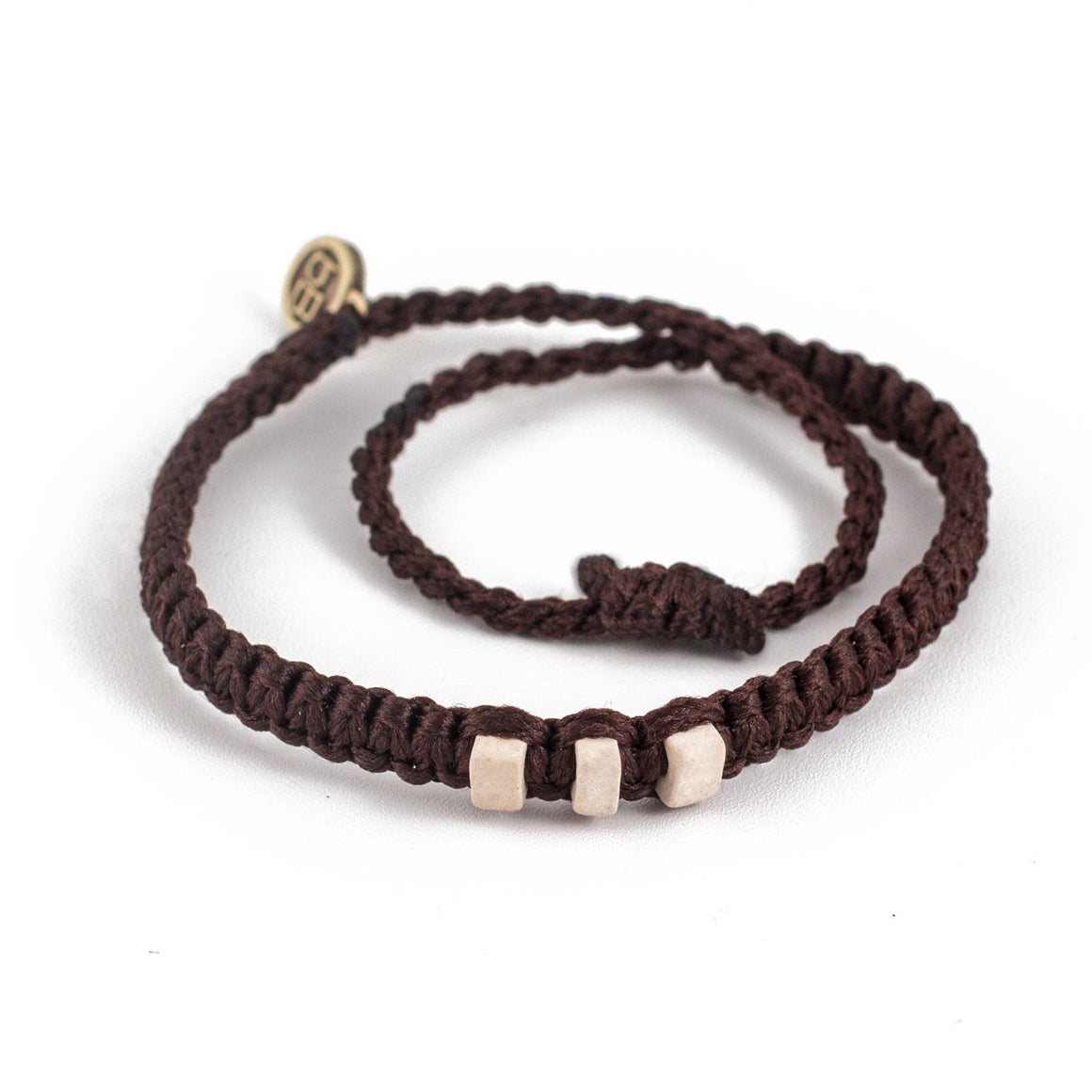 White Chasqui Chocolate Brown bracelets that help children cover