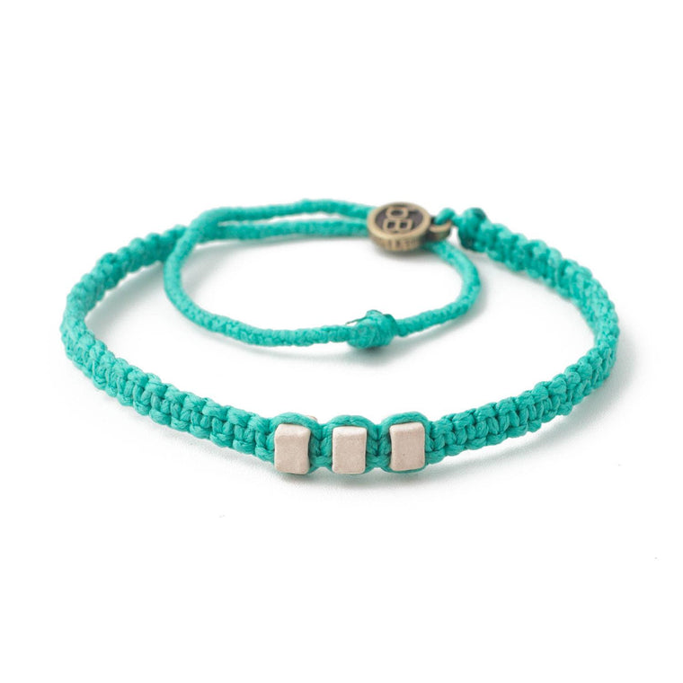 White Chasqui Bright Cyan bracelets that help children cover