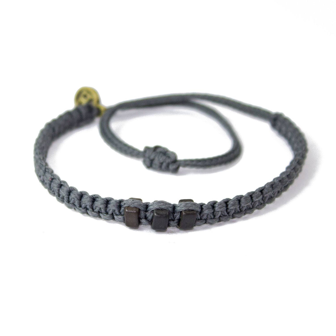Black Chasqui Stone Grey bracelets that help children cover