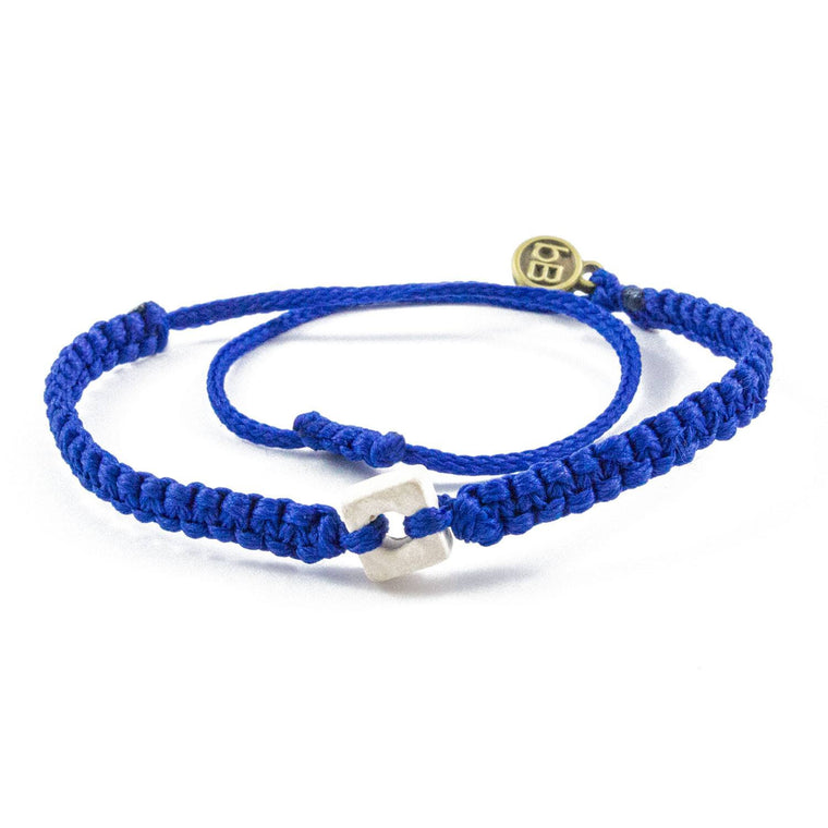 White Raymi Electric Blue bracelets that fight poverty cover