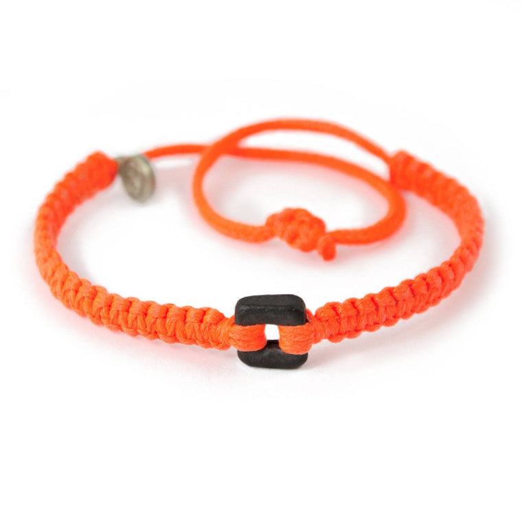 Black Raymi Crayola Orange bracelets that fight poverty cover