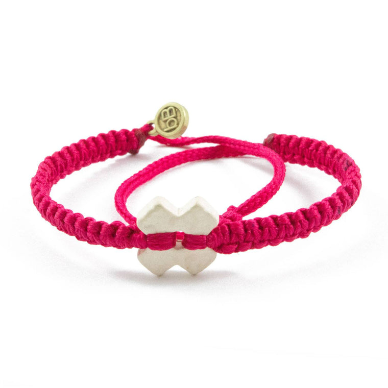 White Tinkus Strawberry Pink donation bracelets cover