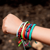 Black Cuzco Candy Pink bolivian bracelets on wrist