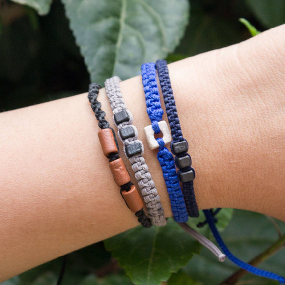 Black Chasqui Dark Blue bracelets that help children cover