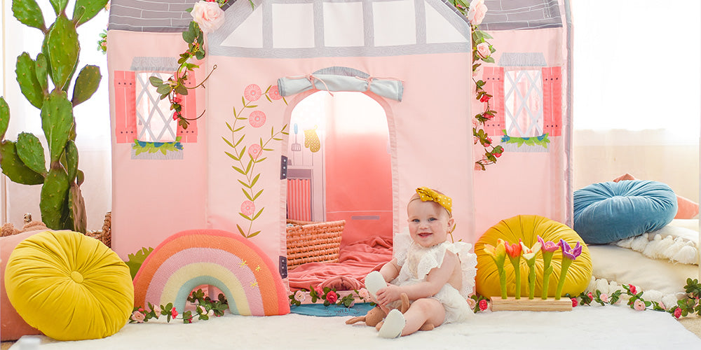 cute baby sitting in front of The Dream House