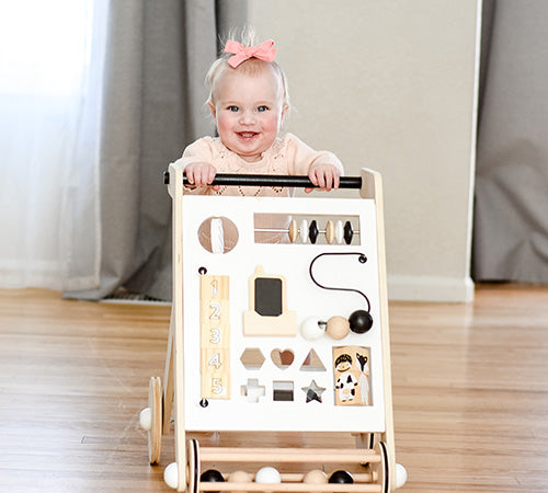 cute baby playing with the activity walker