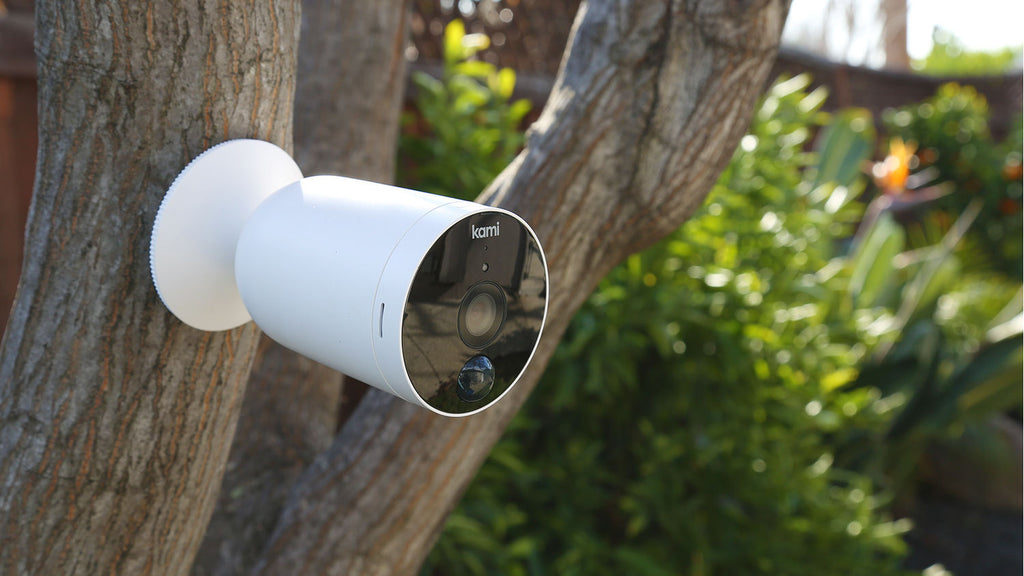 Kami Camera - Wire Free Outdoor Camera - Mounted on tree green leaves background