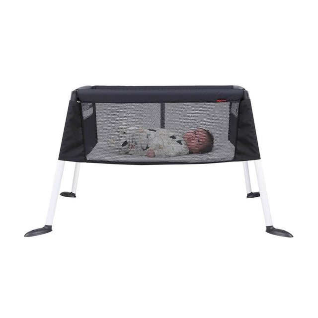 phil&teds traveller portable travel baby cot bassinet with baby side view_default