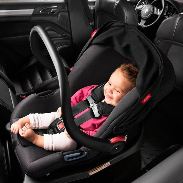 phil&teds alpha car seat with baby sitting in car seat placed in the car_black