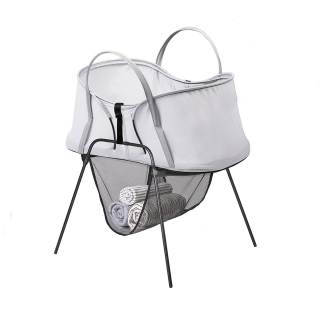 phil&teds carrycot stand with storage basket and nest baby bassinet on top 3/4 view_black