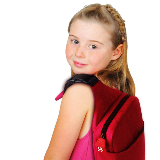 phil&teds mini diddie bag in red strapped on back of young girl_black